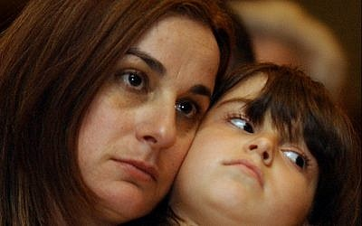 Rona Ramon, left, and her daughter Noa, in Cocoa Beach, Florida, on January 15, 2003 a day before the launch of the space shuttle Columbia. (AP Photo/Alan Diaz, File)