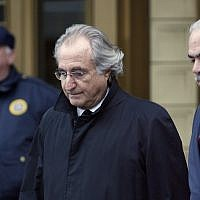 Bernard L. Madoff, the accused mastermind of a $50 billion Ponzi scheme, leaves Federal Court in New York on January 14, 2009. ( AP/Stuart Ramson)