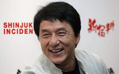 "Hong Kong movie star Jackie Chan smiles during a press conference to promote his film ""Shinjuku Incident"" in Kuala Lumpur, Malaysia, March 31, 2009. (AP Photo/Lai Seng Sin)"