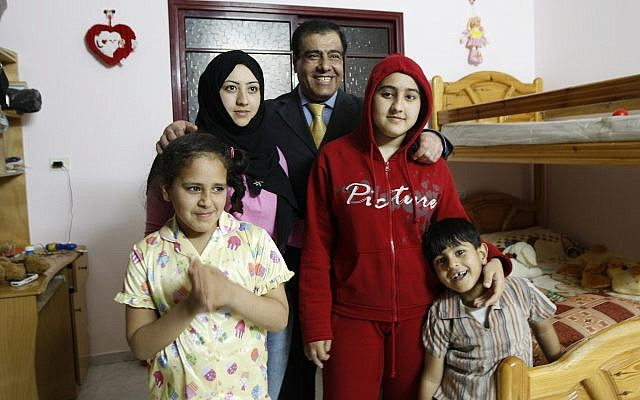 In this May 7, 2009 file photo, Palestinian Dr. Izzeldin Abuelaish poses for a picture with his children in his house in Jebaliya, northern Gaza Strip. (AP Photo/Khalil Hamra, File)