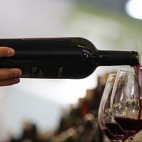 Illustrative: A man pours a glass of red wine at the annual International Wine and Spirits Exhibition 'Vinitaly,' in Verona, northern Italy, on April 8, 2010. (AP Photo/Luca Bruno)