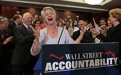 Heather Booth, executive director, Americans for Financial Reform, at podium, cheers during a news conference on Capitol Hill in Washington, July 15, 2010, to discuss financial reform legislation. (AP Photo/Alex Brandon)