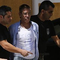 Seif al-Din MohamedIn this Friday, April 22, 2016 file photo, EgyptAir plane hijacking suspect Seif al-Din Mohamed Mostafa, 59, center, is escorted by Cyprus police officers as he arrives in a court in capital Nicosia, Cyprus (AP Photo/Petros Karadjias, File)