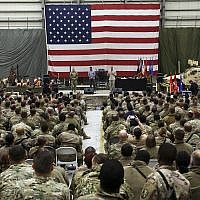 Gen. Joseph Dunford, chairman of the US Joint Chiefs of Staff speaks during a ceremony on Christmas Eve at a US airfield in Bagram, north of Kabul, Afghanistan, December 24, 2017. (AP/Rahmat Gul)