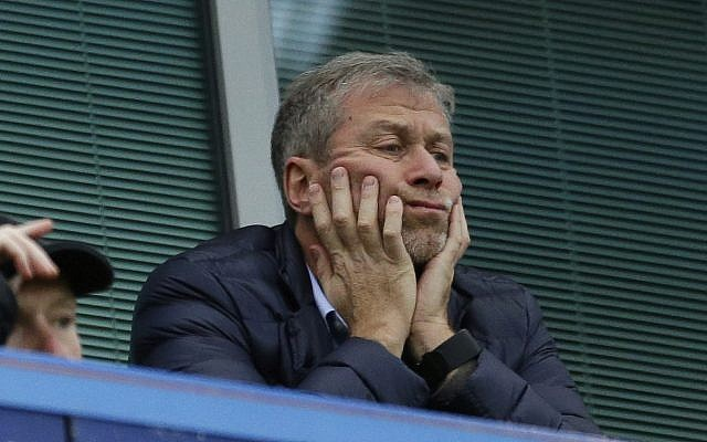 In this file photo dated Saturday, Dec. 19, 2015, Chelsea soccer club owner Roman Abramovich sits in his box before the English Premier League soccer match between Chelsea and Sunderland at Stamford Bridge stadium in London (AP Photo/Matt Dunham, File)