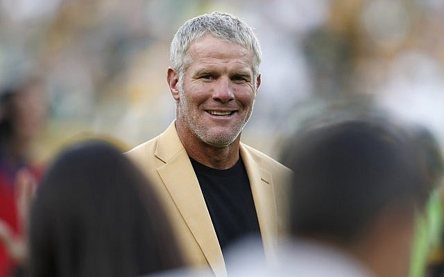 Hall of Fame quarterback Brett Favre is shown during a halftime ceremony of an NFL football game against the Dallas Cowboys, in Green Bay, Wisconsin, October 16, 2016. (AP Photo/Matt Ludtke, File)
