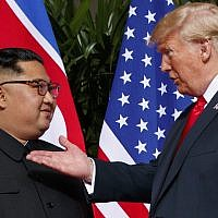 US President Donald Trump, right, meets with North Korean leader Kim Jong Un on Sentosa Island in Singapore, June 12, 2018. (Evan Vucci/AP)