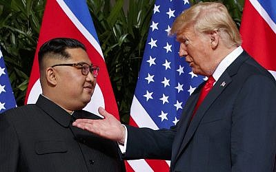 US President Donald Trump, right, meets with North Korean leader Kim Jong Un on Sentosa Island in Singapore, June 12, 2018. (Evan Vucci/AP)