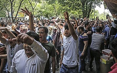 A group of protesters chant slogans at the old grand bazaar in Tehran, Iran, June 25, 2018. (Iranian Labor News Agency via AP)
