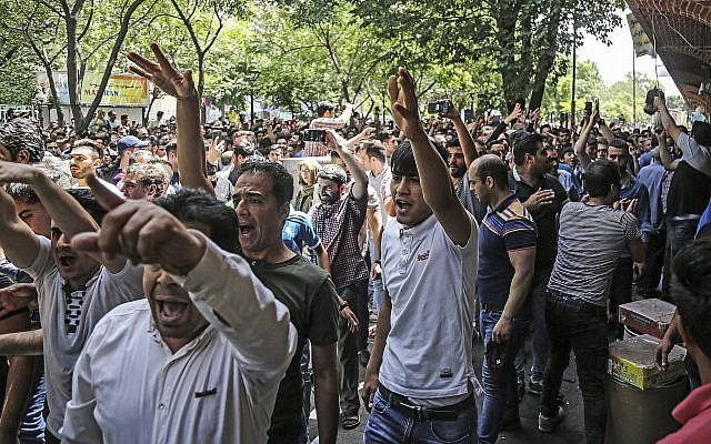 Illustrative: A group of protesters chant slogans at the old grand bazaar in Tehran, Iran, June 25, 2018. (Iranian Labor News Agency via AP)