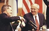 In this Sept. 9, 1990 file photo US President George H. W. Bush shakes hands with Soviet President Mikhail Gorbachev at the conclusion of their joint news conference ending the one day summit in Helsinki, Finland (AP Photo/Liu Heung Shin, file)