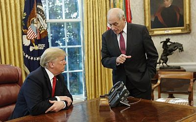 US President Donald Trump listens to White House Chief of Staff John Kelly, right, in the Oval Office of the White House on October 10, 2018. (AP Photo/Pablo Martinez Monsivais)