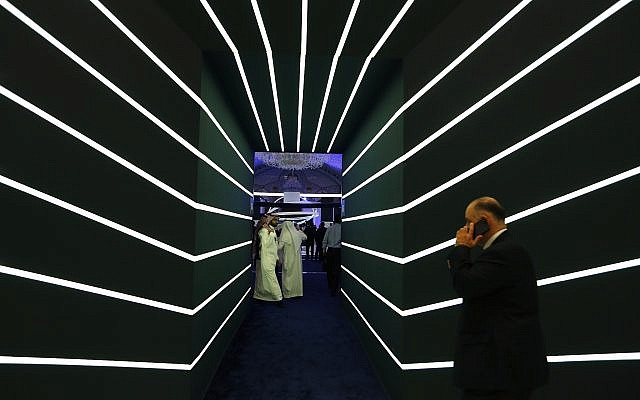 Participants enter meeting rooms at the Future Investment Initiative conference, in Riyadh, Saudi Arabia, Wednesday, Oct. 24, 2018. (AP/Amr Nabil)