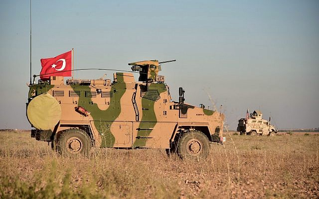 In this photo taken Thursday, November 1, 2018, Turkish and US troops conduct joint patrols around the Syrian town of Manbij, as part of an agreement that aimed to ease tensions between the two NATO allies. (Turkish Defence Ministry via AP, Pool)