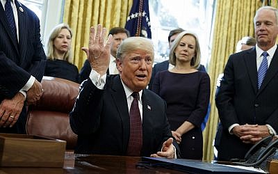 "President Donald Trump answers a reporters question about the investigation of special counsel Robert Mueller during a signing ceremony of the ""Cybersecurity and Infrastructure Security Agency Act,"" in the Oval Office of the White House, Friday, November 16, 2018, in Washington. (AP/Evan Vucci)"