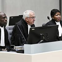 ICCs prosecutor Fatou Bensouda, right, and deputy prosecutor James Stewart, center, at the International Criminal Court, ICC, in The Hague, Netherlands, Friday Nov. 23, 2018. (Piroschka van de Wouw/pool/AP)