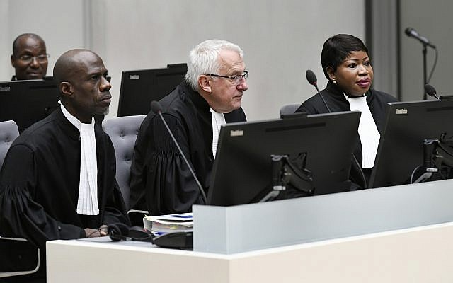 ICC's prosecutor Fatou Bensouda, right, and deputy prosecutor James Stewart, center, at the International Criminal Court, ICC, in The Hague, Netherlands, Friday Nov. 23, 2018. (Piroschka van de Wouw/pool/AP)