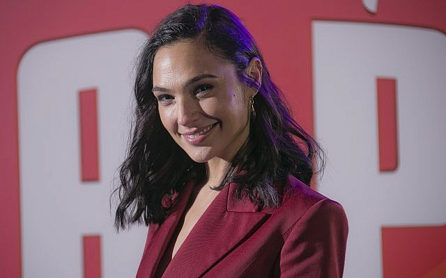 Actress Gal Gadot poses for photographers upon arrival at the premiere of the film 'Ralph Breaks the Internet' in central London on November 25, 2018. (Joel C Ryan/Invision/AP)