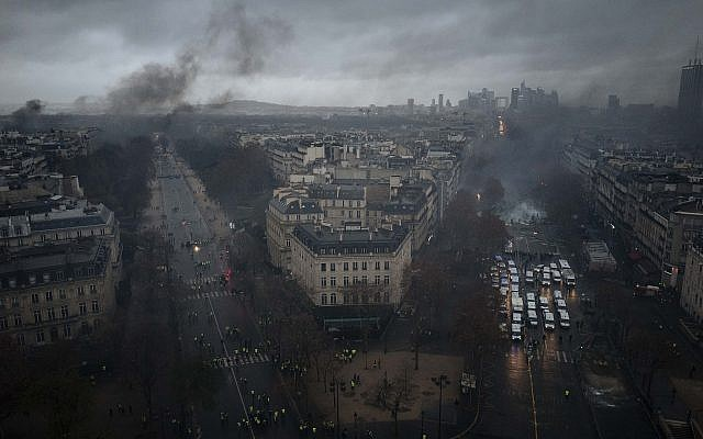 Avenues leading to the Arc de Triomphe are pictured from the top of the Arc de Triomphe on the Champs-Elysees avenue during a demonstration, Dec.1, 2018 in Paris.  (AP Photo/Kamil Zihnioglu)