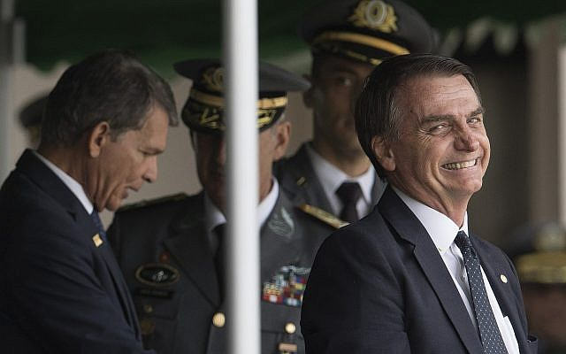 Brazil's President-elect Jair Bolsonaro smiles as he attends the Army cadets graduation ceremony at the Military Academy of Agulhas Negras in Resende, Brazil, December 1, 2018. (AP Photo/Leo Correa)