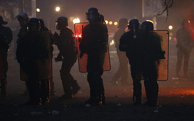 French riot police officers take position during a demonstration, Dec.1, 2018 in Paris (AP Photo/Thibault Camus)