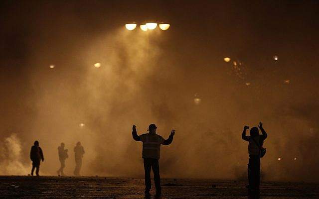 Demonstrators attend a demonstration near the Arc de Triomphe, Dec.1, 2018 in Paris (AP Photo/Kamil Zihnioglu)