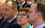 In this Wednesday, November 21, 2018 file photo, Friedrich Merz, former German Christian Democratic Union faction leader, left, Annegret Kramp-Karrenbauer, General Secretary of the CDU, and Germany's Health Minister Jens Spahn, right, all members of the CDU, attend a party regional conference candidates for the CDU chairmanship in Seebach, central Germany. (AP Photo/Jens Meyer, file)
