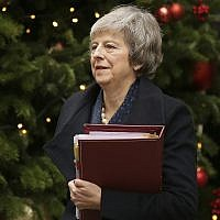 Britain's Prime Minister Theresa May leaves 10 Downing Street to attend the weekly Prime Ministers' Questions session, at parliament in London, Dec. 12, 2018 (AP Photo/Tim Ireland)
