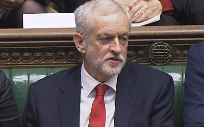 Labour leader Jeremy Corbyn says something under his breath after the British Prime Minister Theresa May likened Labour's attempt to table a no confidence motion in her to a pantomime, during the weekly Prime Minister's Questions in the House of Commons, London, December 19, 2018 (House of Commons/PA via AP)