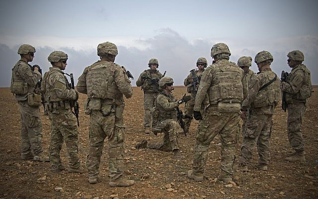 US soldiers gather for a brief during a combined joint patrol rehearsal in Manbij Syria