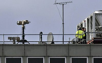 Counter drone equipment is deployed on a rooftop at Gatwick airport in Gatwick, England, December 21, 2018 (John Stillwell/PA via AP)