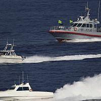 Illustrative: Patrol boats belonging to Iran's Islamic Revolutionary Guard Corps shadow the USS John C. Stennis aircraft carrier on December 21, 2018 (AP /Jon Gambrell)