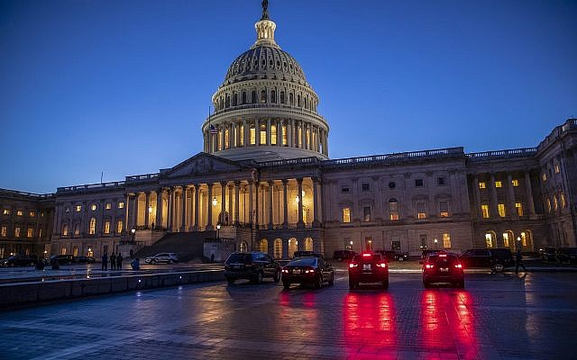 The Capitol is seen at day's end as the Senate works on a House-passed bill that would pay for President Donald Trump's border wall and avert a partial government shutdown, at the Capitol in Washington, December 21, 2018. (AP Photo/J. Scott Applewhite)