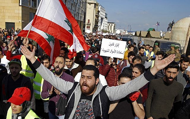Lebanese anti-government protesters chant slogans during a protest in downtown Beirut, Lebanon, Dec. 23, 2018  (AP Photo/Bilal Hussein)