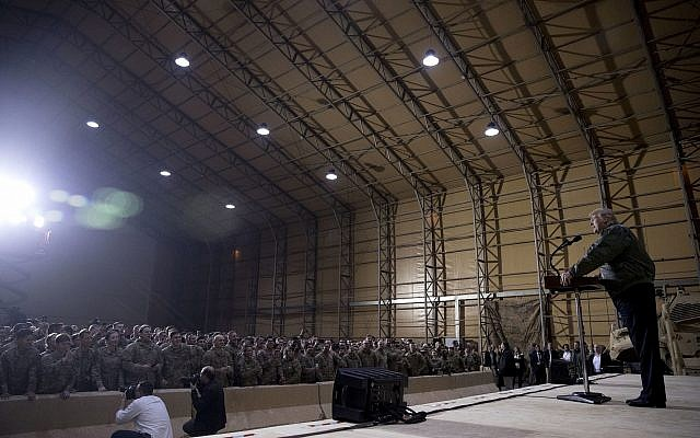 President Donald Trump speaks at a hanger rally at Al Asad Air Base, Iraq, Wednesday, Dec. 26, 2018. (AP/Andrew Harnik)