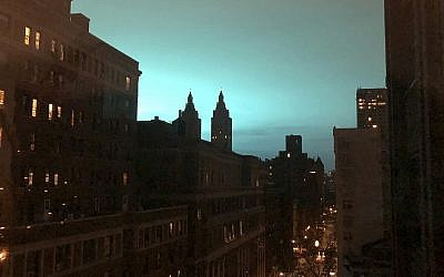 This photo shows blue light over New York, as seen from Manhattan Borough of New York on Thursday, Dec. 27, 2018 (AP Photo/Jay Reeves)