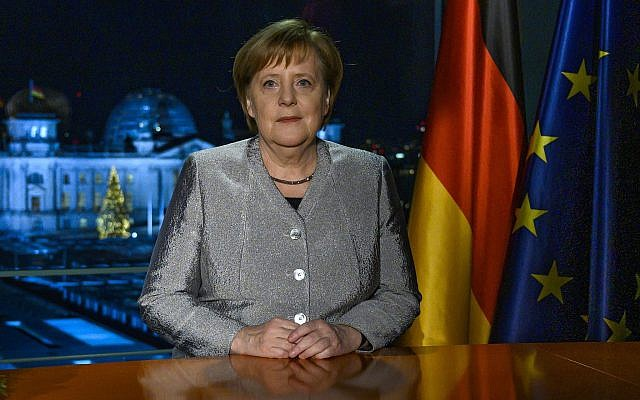 German Chancellor Angela Merkel poses for a photograph after the recording of her annual New Year's speech at the Chancellery in Berlin, Germany, Sunday, Dec. 30, 2018. (John MacDougall/pool photo via AP)