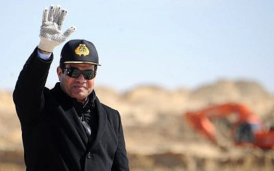 In this photo from February 22, 2015, provided by the Egyptian Presidency, Egyptian President Abdel-Fattah el-Sissi waves during a visit to the Suez Canal in Ismailia, Egypt. (Egyptian Presidency via AP, File)