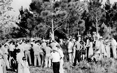 A crowd gathers to view the body of 32-year-old Rubin Stacy as he hangs from a tree in Fort Lauderdale, Fl., on July 19, 1935. Stacy was lynched by a mob of masked men who seized him from the custody of sheriff's deputies for allegedly attacking a white woman. (AP Photo)