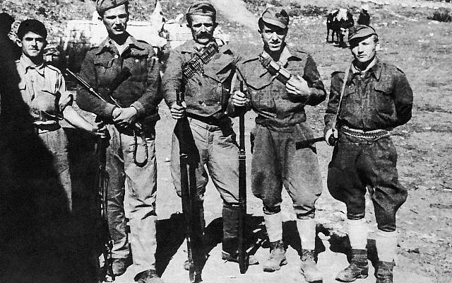Illustrative: An armed escort of the British military mission in Albania in an undated photo. Most of them have been fighting since the Italians landed in 1939. (AP Photo)