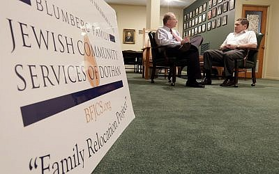 In this Wednesday, October 2, 2013, photo, Larry Blumberg, right, founder of Blumberg Family Jewish Community Services of Dothan, and the program's, executive director, Rob Goldsmith, discuss their relocation program at the Temple Emanu-El in Dothan, Alabama. (AP/Dave Martin)