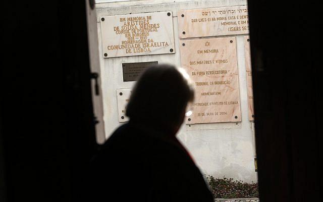 A Jewish woman walks past memorials stones at the main Jewish synagogue in Lisbon, May 5, 2015. (Francisco Seco/AP)