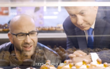 Prime Minister Benjamin Netanyahu looks at donuts traditionally eaten for Hanukkah in a video he released on December 2, 2018, to mark the start of the Jewish holiday. (Screen capture: Facebook)