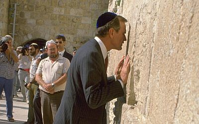 Then US vice president George H.W. Bush prays at the Western Wall in the Old City of Jerusalem. (Government Press Office)