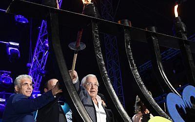 US Ambassador David Friedman, left, lighting a Hanukkah menorah, at the Sultan's Pool in Jerusalem, on December 3, 2018. (Matty Stern/ US Embassy)