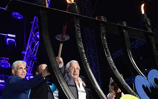 US Ambassador David Friedman, left, lighting a Hanukkah menorah, at the Sultan's Pool in Jerusalem, on December 3, 2018. (Matty Stern/ US Embassy)