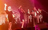 Postmodern Jukebox vocalists, from left, Joey Cook, Brittnie Price, and MC Mario Jose at the show in Tel Aviv on December 16, 2018. (Melanie Lidman/Times of Israel)