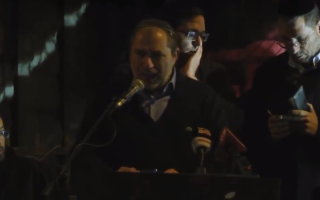 Chaim Silberstein speaks outside the Prime Minister's Residence in Jerusalem at a right-wing rally protesting the government's response to recent terror attacks in the West Bank, on December 13, 2018. (Screen capture: Twitter)