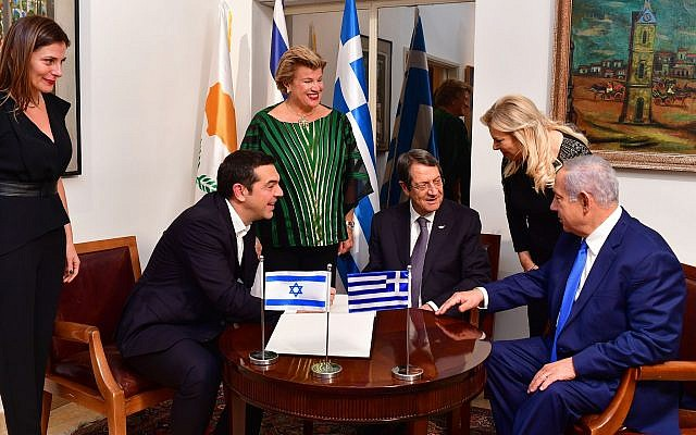 Prime Minister Benjamin Netanyahu (R) and his wife Sara (2R) host Cypriot President Nicos Anastasiades (CR)and his wife Andri Moustakoudi (L)and Greek Prime Minister Tsipras (@L)and his partner Peristera Baziana (L) on December 19, 2018 in Jerusalem. (Kobi Gideon/GPO)