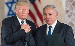 US President Donald Trump, left, and Prime Minister Benjamin Netanyahu shake hands at the Israel Museum in Jerusalem on May 23, 2017. (Yonatan Sindel/Flash90)